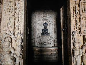 Parvanatha Jina figure in black stone